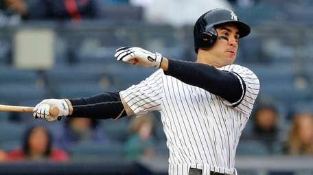 Mike Tauchman #39 of the Yankees follows through