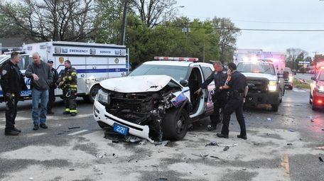 Investigators at the crash scene on Walt Whitman