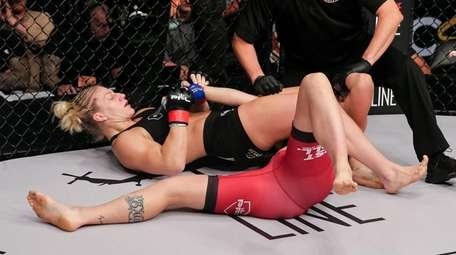 Kayla Harrison applies an armbar submission to Brittney