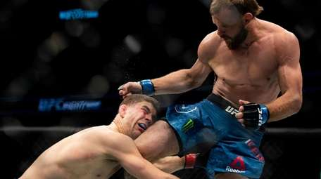 Al Iaquinta, left, fights with Donald Cerrone in