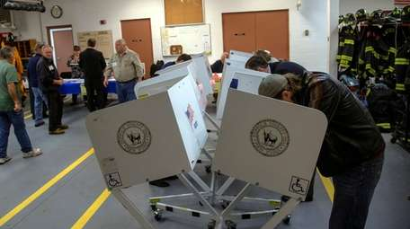 Voters cast their ballots at the Eatons Neck