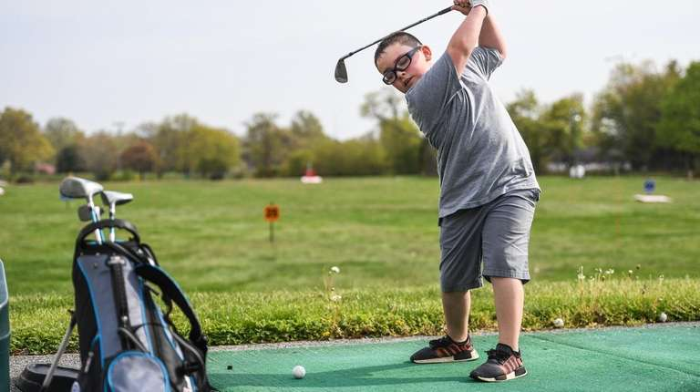 Declan Stack, 7, of Hicksville, who golfs with