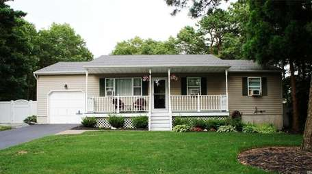 This Manorville ranch, with three bedrooms and three