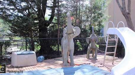 Sculptures near the home's swimming pool.