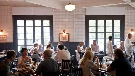 Diners linger over their suppers at Almond restaurant