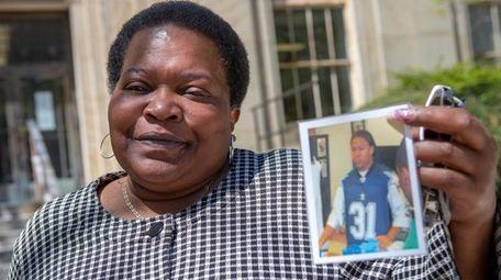 Gerry Flowers, Daniel Flowers' aunt, holds a photo