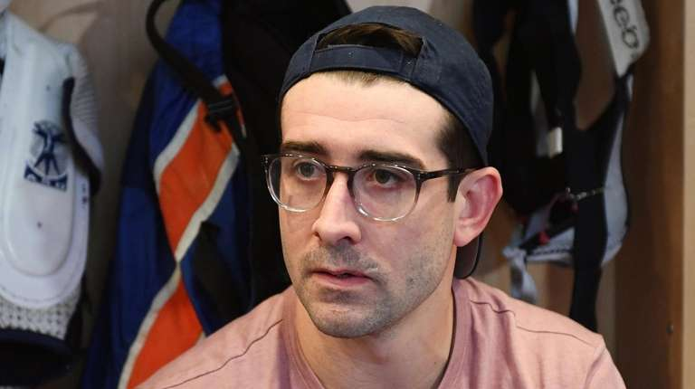 Islanders right wing Cal Clutterbuck speaks with the