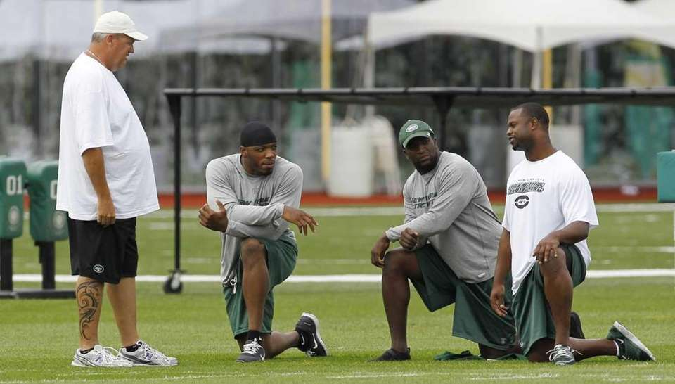 New York Jets head coach Rex Ryan, left,