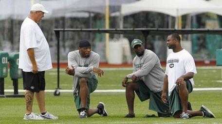 New York Jets head coach Rex Ryan, left,