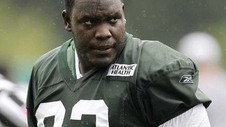New York Jets defensive tackle Kenrick Ellis walks
