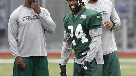 New York Jets cornerback Darrelle Revis (24) laughs