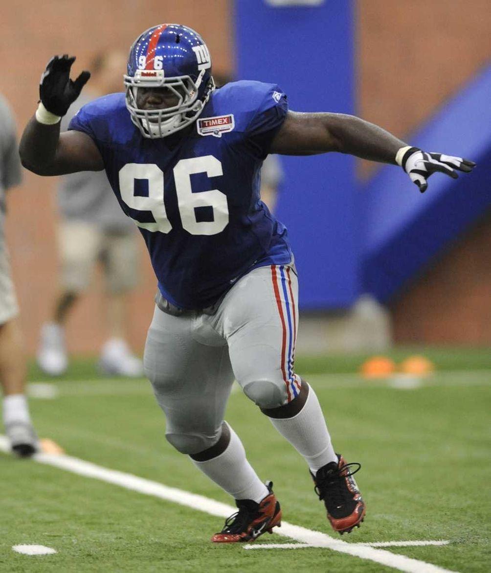 New York Giants defensive tackle Marvin Austin runs