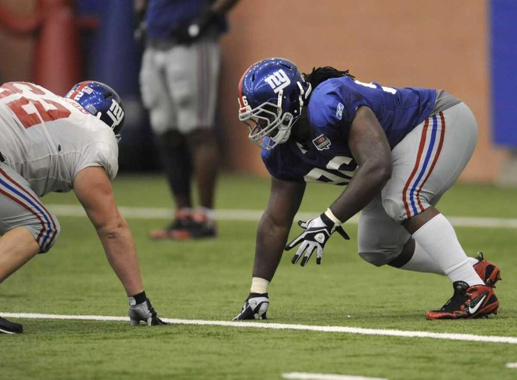 New York Giants defensive tackle Marvin Austin, right,