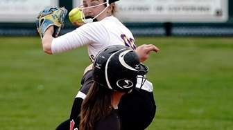 East Islip's Jenny MUrphy (10) is forced at
