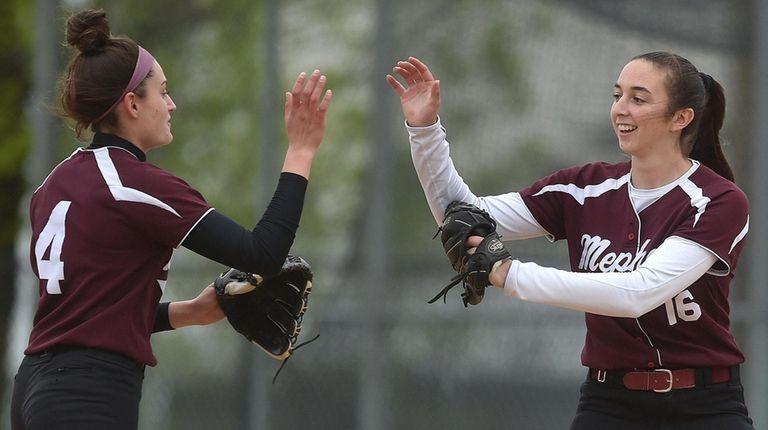 Mepham shortstop Stefanie Simone, left, and Brianna Morse