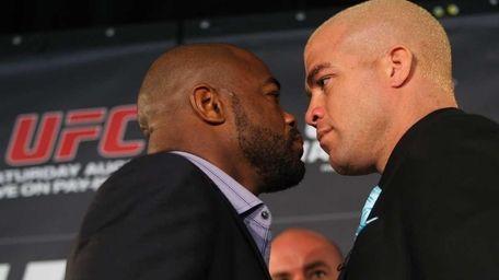 Former UFC light heavyweight champion Rashad Evans, left