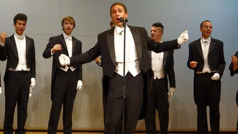 Commack valedictorian Mike Young, center, sings a solo