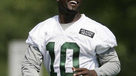 New York Jets wide receiver Santonio Holmes smiles