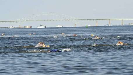 Swimmers participate in Friday's 5.25-mile Maggie Fischer Cross