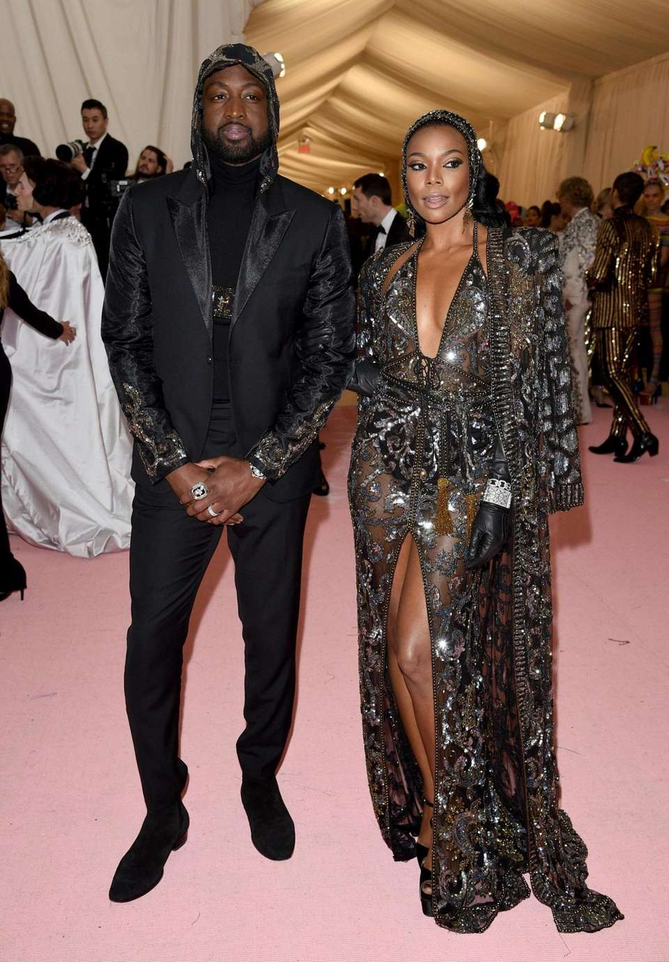 Dwyane Wade, left, and Gabrielle Union attend The