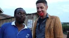 Filmmaker Isaac Nabwana, left, and East Northport native