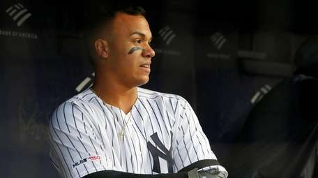 Thairo Estrada stands in the Yankees dugout after