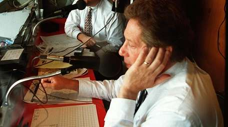 John Sterling is shown in the announcers booth