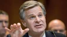 FBI Director Christopher Wray testifies on Capitol Hill