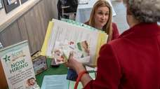 Scope Education Services' Michele Sebor conversing with Daniella