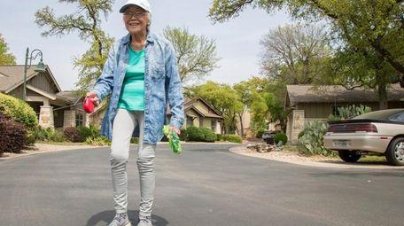 Marcelina Lazo, 90, walks her dog, Yumiko, in