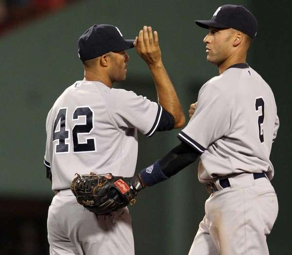Mariano Rivera and Derek Jeter celebrate the win