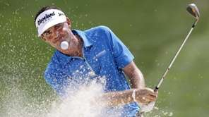 Keegan Bradley hits from the sand to the