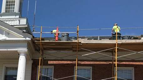Workers putting in a new roof at Babylon