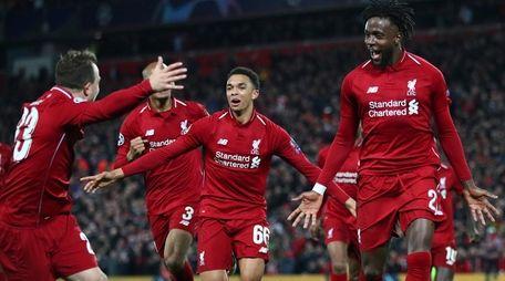 Divock Origi of Liverpool (27) celebrates as he