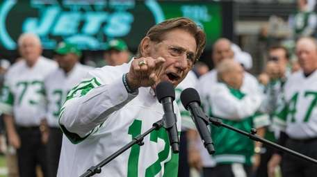 Joe Namath speaks during a halftime celebration of