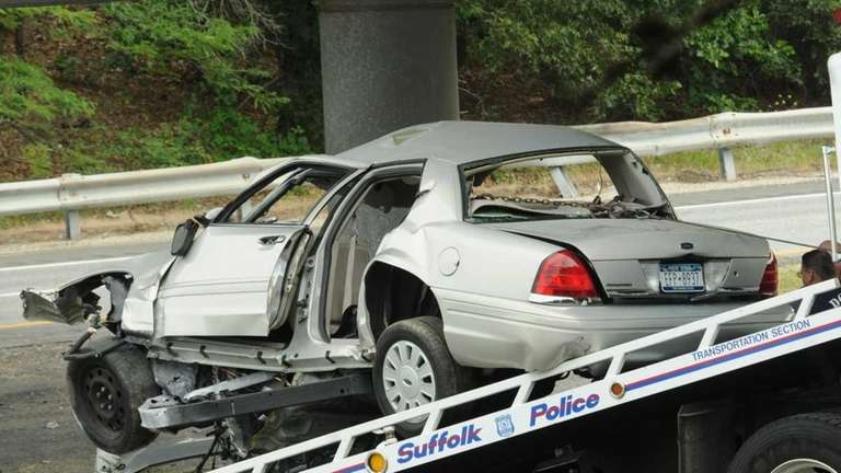 A wrecked unmarked Suffolk County police car sits