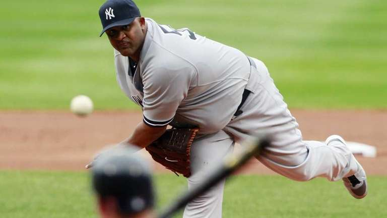 New York Yankees' CC Sabathia pitches in the