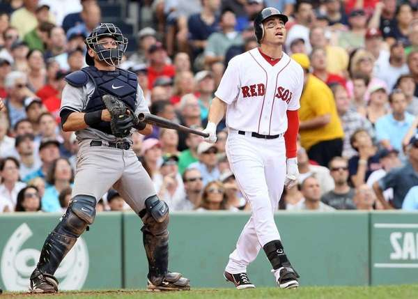 Jacoby Ellsbury of the Boston Red Sox watches