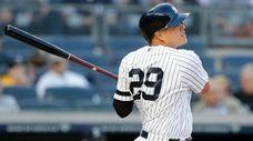 Gio Urshela of the Yankees follows through on