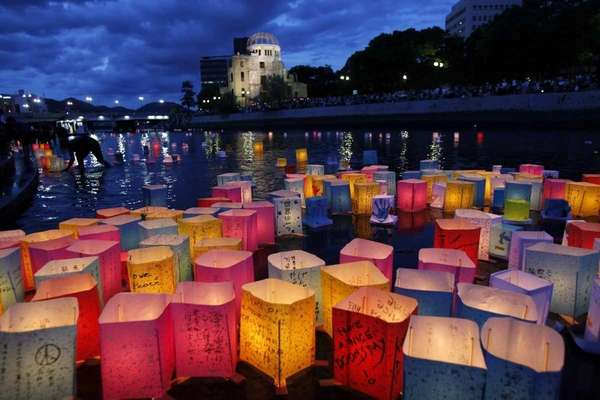 Paper lanterns float along the Motoyasu River in