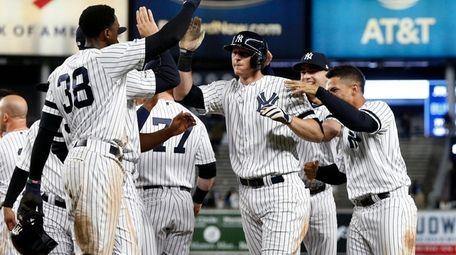 DJ LeMahieu of the Yankees celebrates his ninth-inning