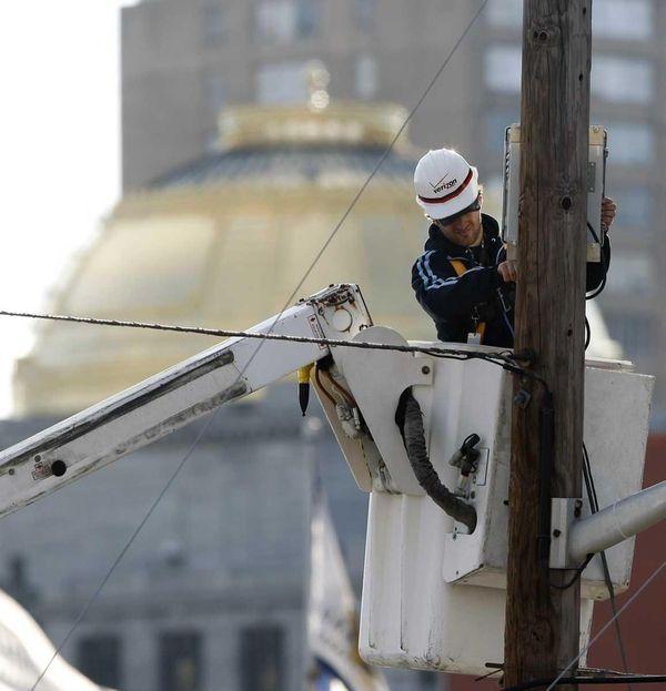 A Verizon worker is seen working near city
