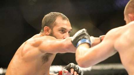 Johny Hendricks, left, throws a punch at Mike