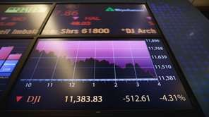 An electronic board displays trading activity on the
