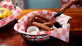 Hot, sweet and crunchy: churros served with chocolate