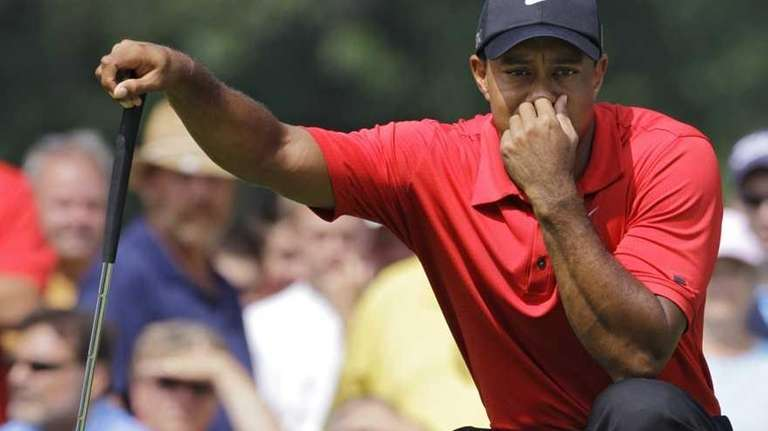 Tiger Woods looks over an eagle putt on
