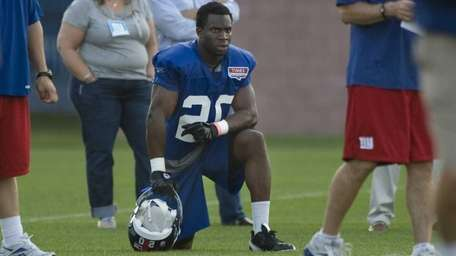 Prince Amukamara watches practice from the sidelines during