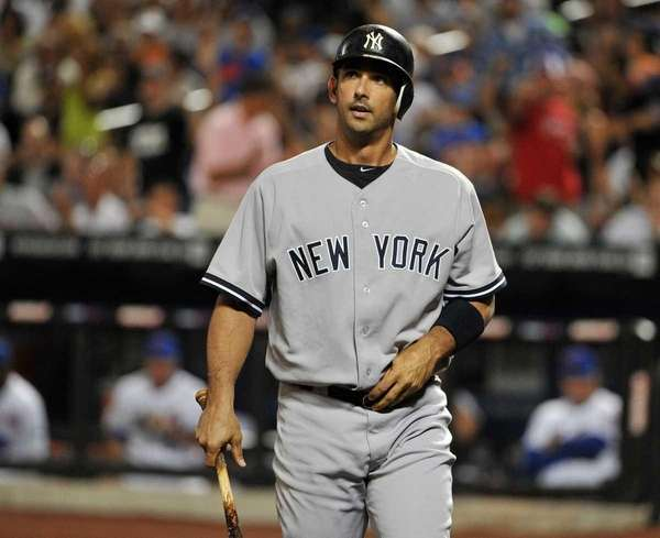 New York Yankees designated hitter Jorge Posada reacts