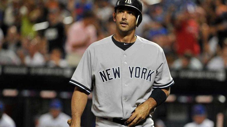 New York Yankees designated hitter Jorge Posada reacts