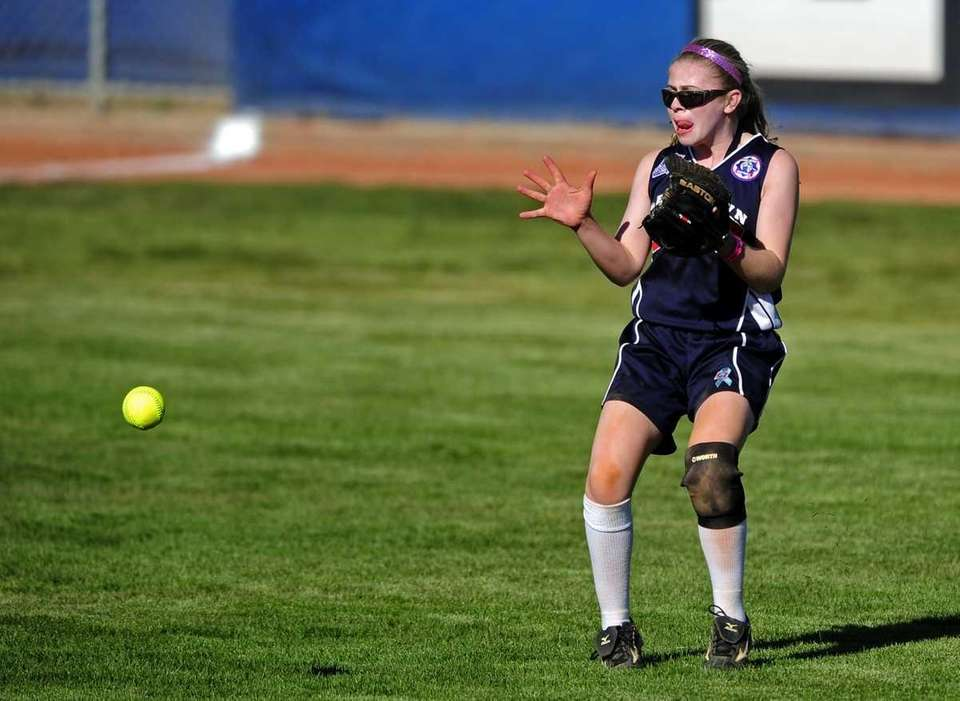 Levittown left fielder Kaitlin Mars gathers in a